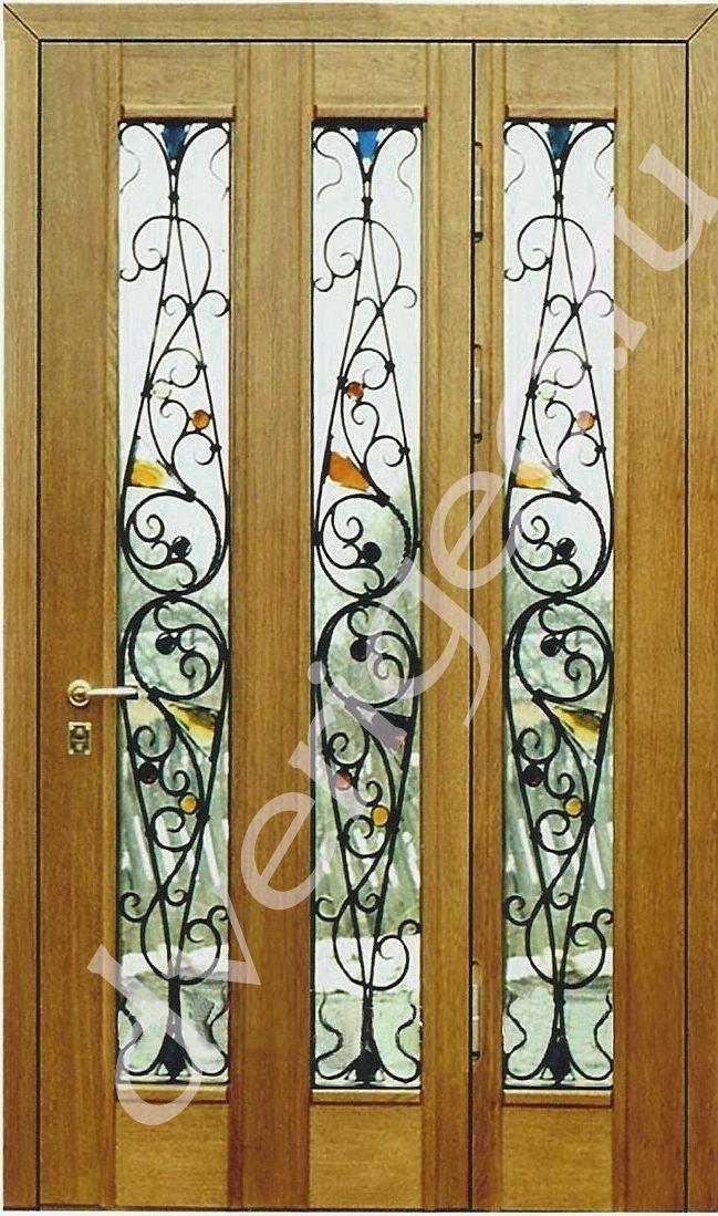 входные двухстворчатые двери с ковкой и витражом